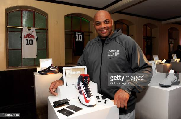 Charles Barkley poses with the latest basketball innovation the Nike Hyperdunk which measures how high how hard and how quick ballers play the game...