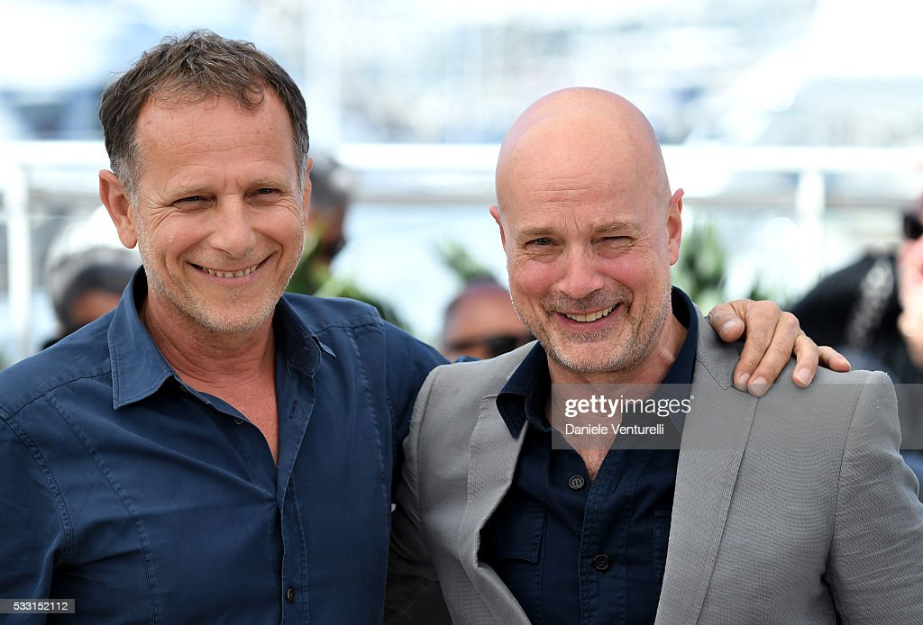 Charles Berling and Christian Berkel attend the 'Elle' Photocall during the 69th annual Cannes Film Festival at the Palais des Festivals on May 21...