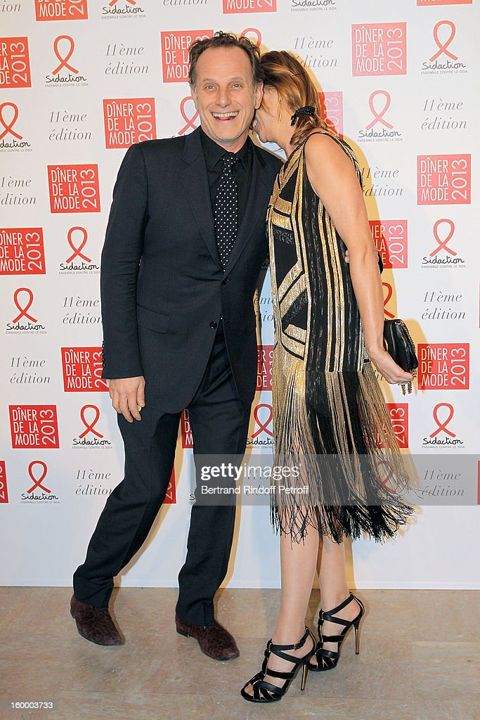 Charles Berling (L) and his companion Virginie Couperie-Eiffel pose as they arrive to attend the Sidaction Gala Dinner 2013 at Pavillon d'Armenonville on January 24, 2013 in Paris, France.