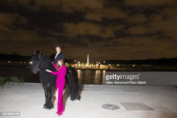 Charles Berling and Marina Hands are photographed for Paris Match at the start of the Longines Global Champions Tour Paris Eiffel on June 26 2014 in...