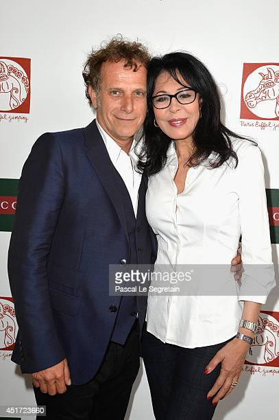 Charles Berling and Yamina Benguigui attend the Paris Eiffel Jumping presented by Gucci at ChampdeMars on July 5 2014 in Paris France