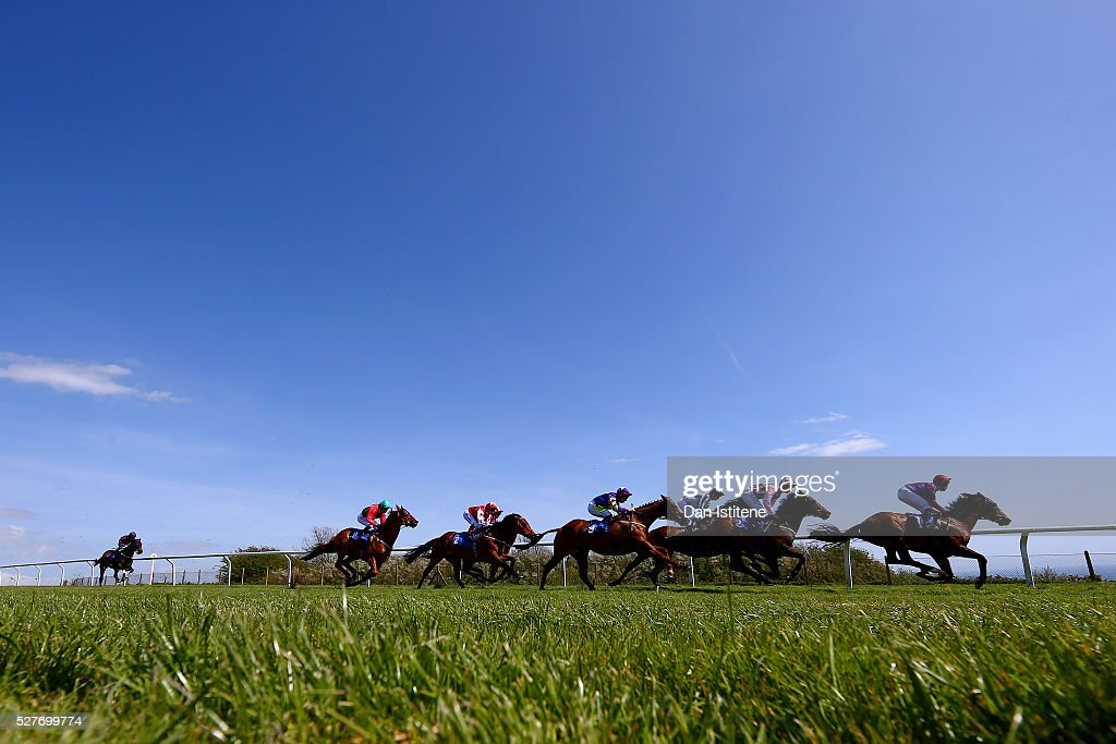 Charles Bishop leads the field riding Jaywalker during the L&S Printing - Official Print Partner Handicap Stakes at Brighton Racecourse on May 3, 2016 in Brighton, England.