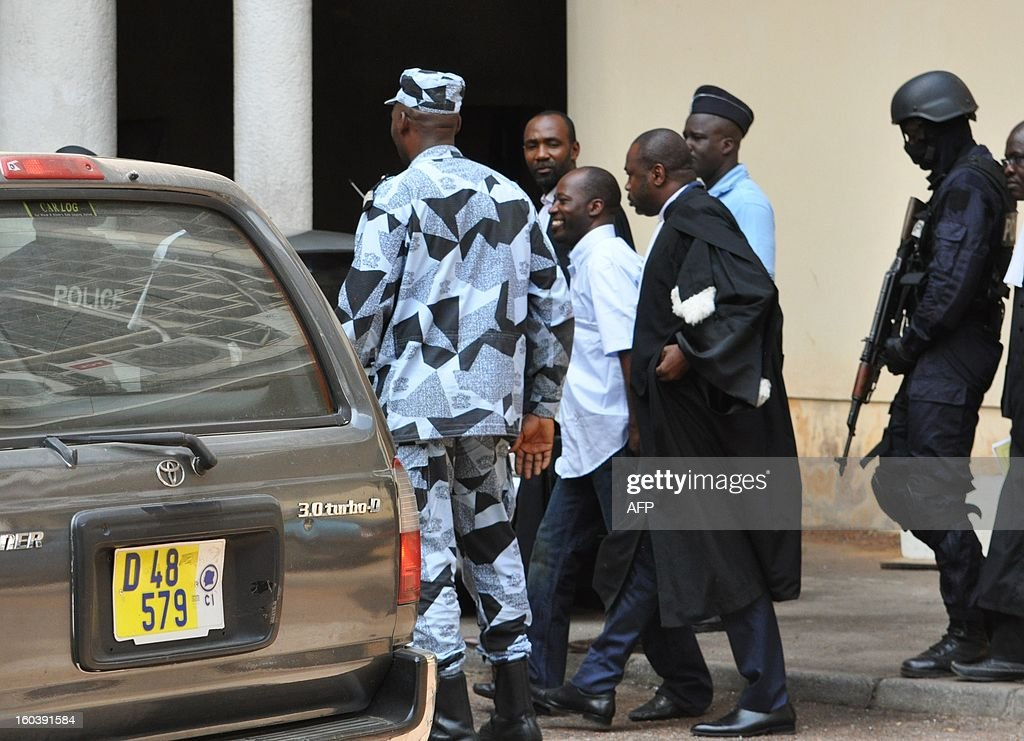 Charles Ble Goude (C), a former general who served under fallen Ivory Coast strongman Laurent Gbagbo, leaves a court hearing in Abidjan on January 30, 2013. Goude was arrested in Ghana on January 17 and extradited the following day to Ivory Coast where he now faces charges of 'war crimes'. AFP PHOTO / Kanga Koffi Firmin Junior