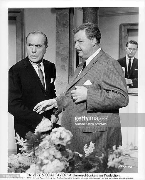 Charles Boyer and Walter Slezak are looking at something upsetting in the lobby in a scene from the film 'A Very Special Favor' 1965
