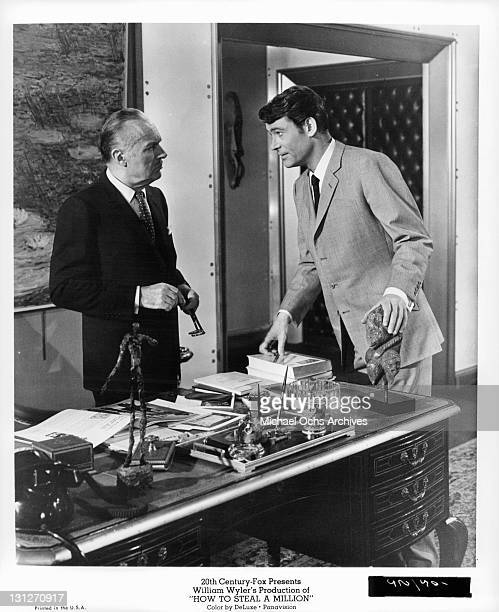 Charles Boyer talking to Peter O'Toole in a scene from the film 'How To Steal A Million' 1966