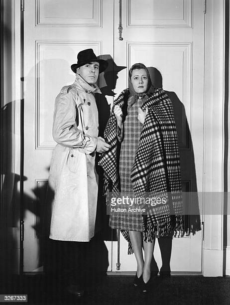 Charles Boyer the French romantic actor of international renown and Irene Dunne the American leading lady in a tense scene from 'When Tomorrow Comes'...