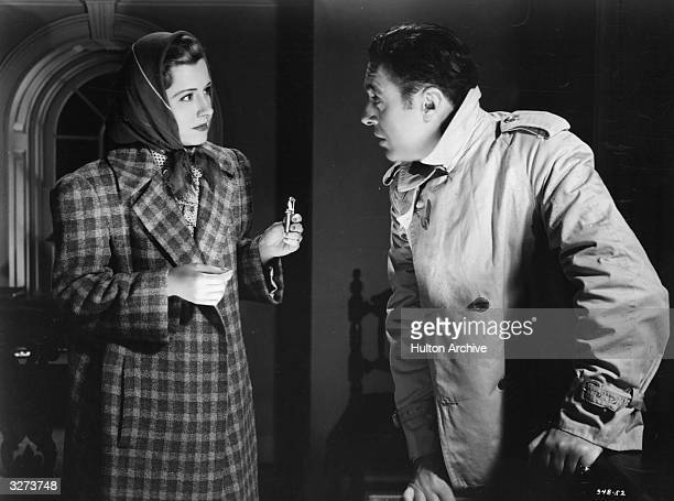 Charles Boyer the French romantic actor of international renown and Irene Dunne the American leading lady are viewed in a tense scene from 'When...