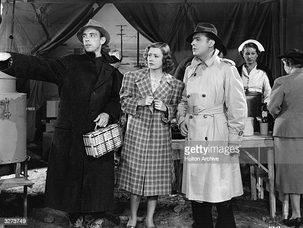 Charles Boyer the French romantic actor of international renown and Irene Dunne the American leading lady are viewed in a scene from 'When Tomorrow...