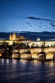 Illuminated Charles Bridge with Prague Castle at Dusk