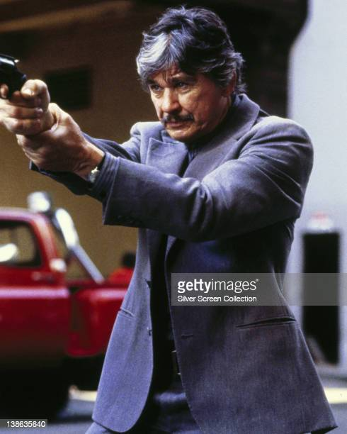 Charles Bronson US actor aiming a handgun in an image issued as publicity for the film 'Death Wish 3' Great Britain 1985 The action film directed by...