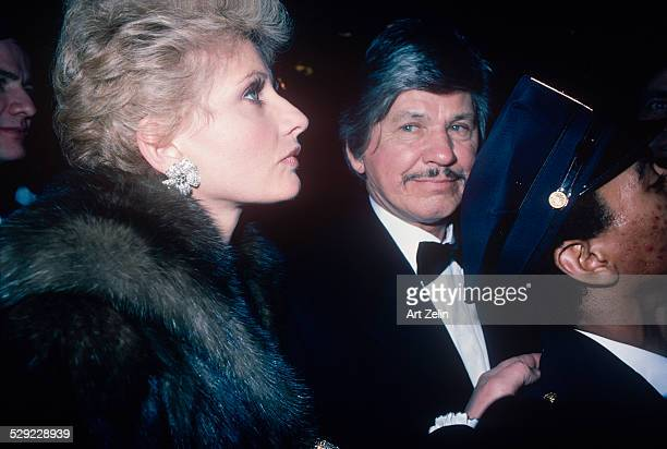 Charles Bronson with his wife Jill Ireland he is in a tux she is wearing a fur circa 1970 New York