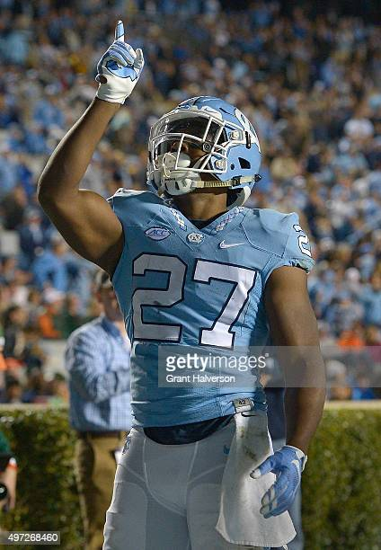 Charles Brunson of the North Carolina Tar Heels reacts after scoring a touchdown against the Miami Hurricanes during their game at Kenan Stadium on...