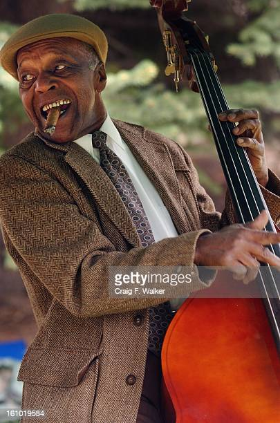 Charles Burrell of the Denver Municipal Band Jazz Trio plays his bass for the crowd gather for the dedication of Madam CJ Walker Park A'Lelia Bundles...