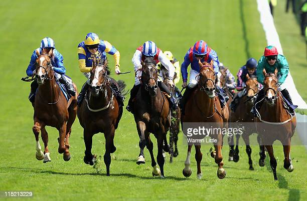 Charles Camoin ridden by Liam Keniry wins the The Investec Horses Help Heros STakes during The Derby Festival at Epsom Racecourse on June 4 2011 in...