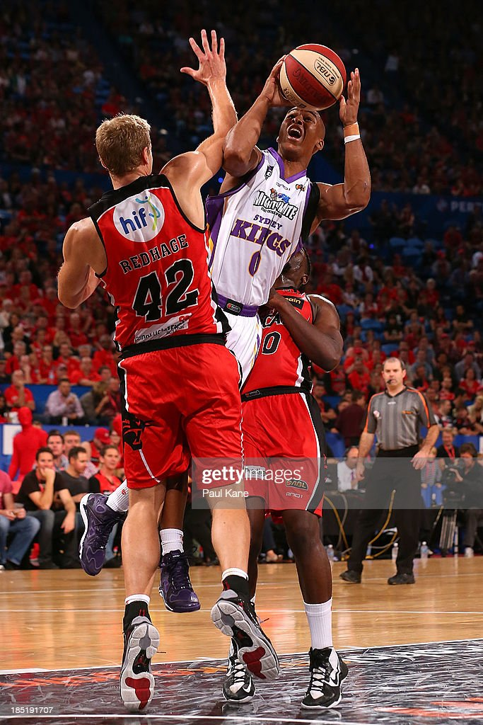 Charles Carmouche of the Kings drives to the basket against Shawn Redhage of the Wildcats during the round two NBL match between the Perth Wildcats and the Sydney Kings at Perth Arena in October 18, 2013 in Perth, Australia.