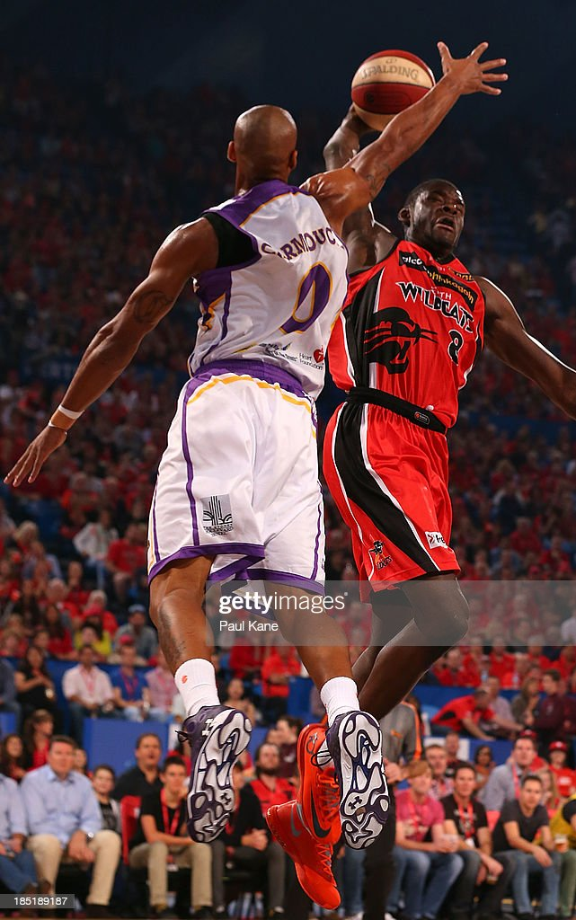 Charles Carmouche of the Kings look to block James Ennis of the Wildcats during the round two NBL match between the Perth Wildcats and the Sydney Kings at Perth Arena in October 18, 2013 in Perth, Australia.