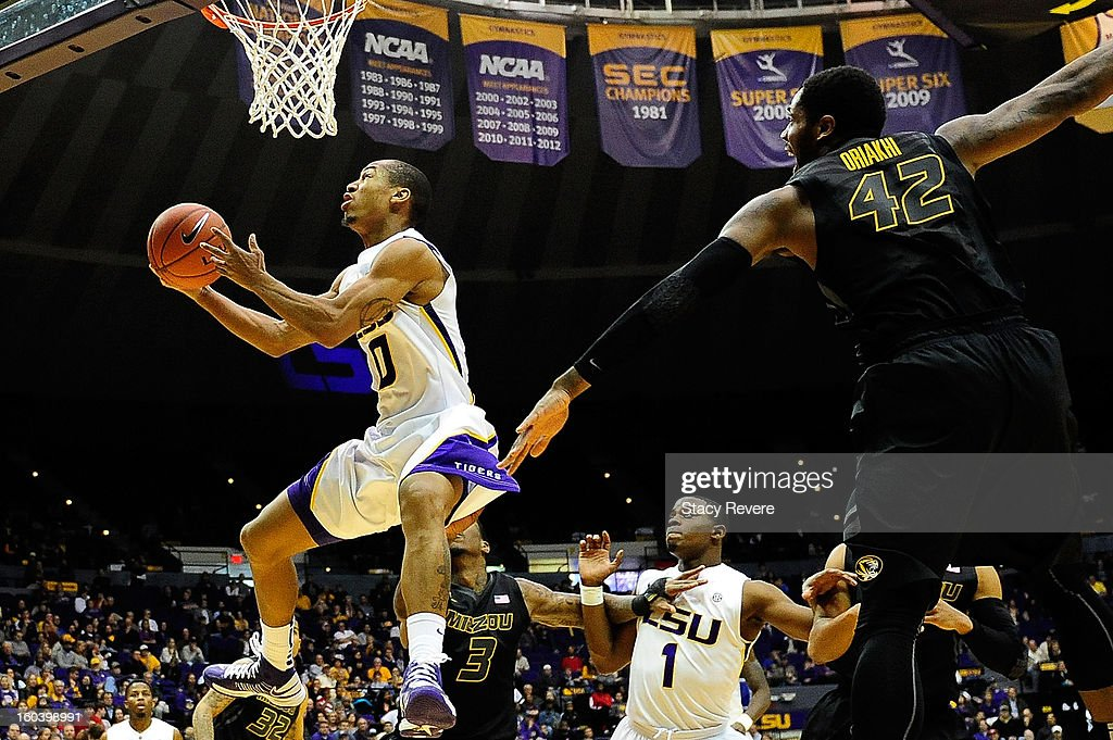 Charles Carmouche #0 of the LSU Tigers drives to the basket during a game against the Missouri Tigers at the Pete Maravich Assembly Center on January 30, 2013 in Baton Rouge, Louisiana.