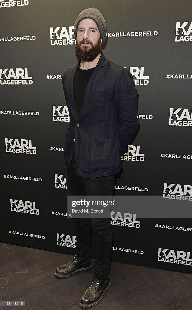 Charles Cave of The White Lies attend the Karl Lagerfeld European flagship store launch on March 13 2014 in London England