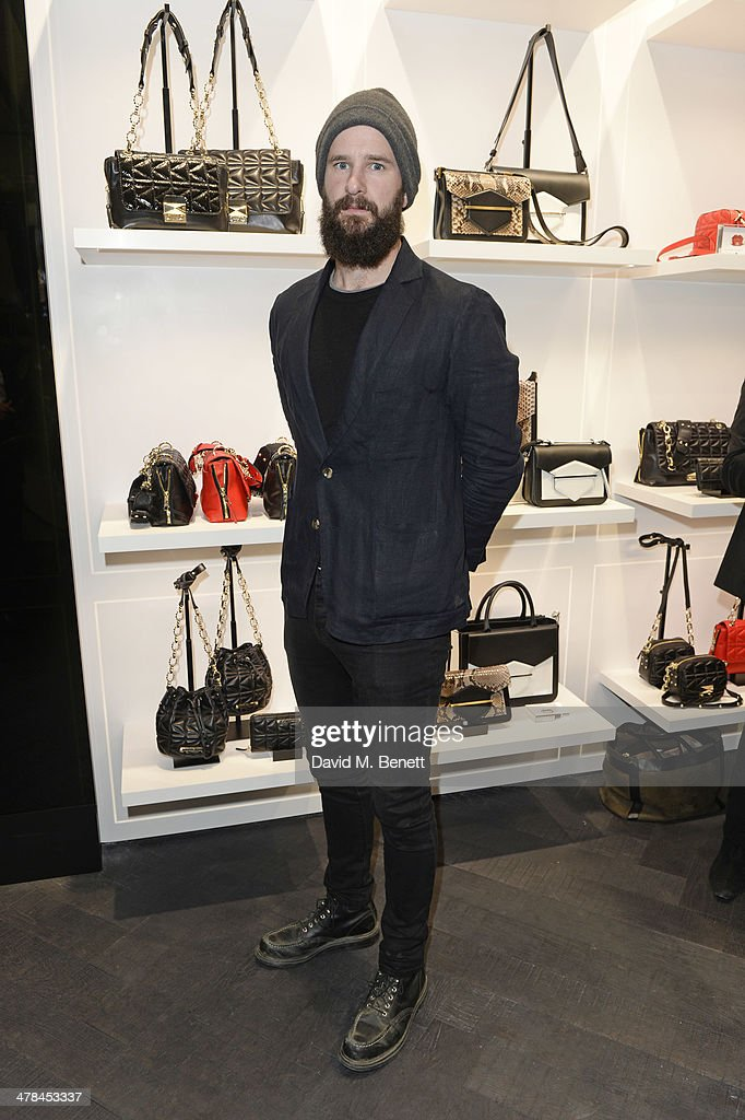 Charles Cave of 'The White Lies' attends the Karl Lagerfeld European flagship store launch on March 13 2014 in London England