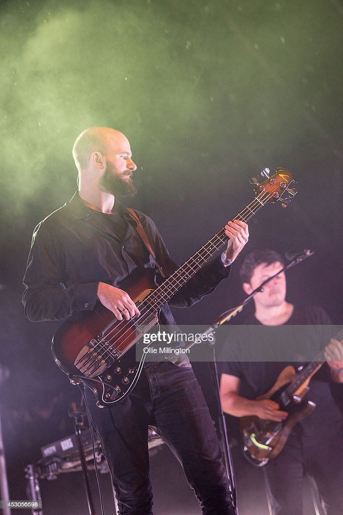 Charles Cave of White Lies performs on stage headlingin the main stage at the end of day 1 at Y Not Festival at Pikehall on August 1 2014 in Matlock...
