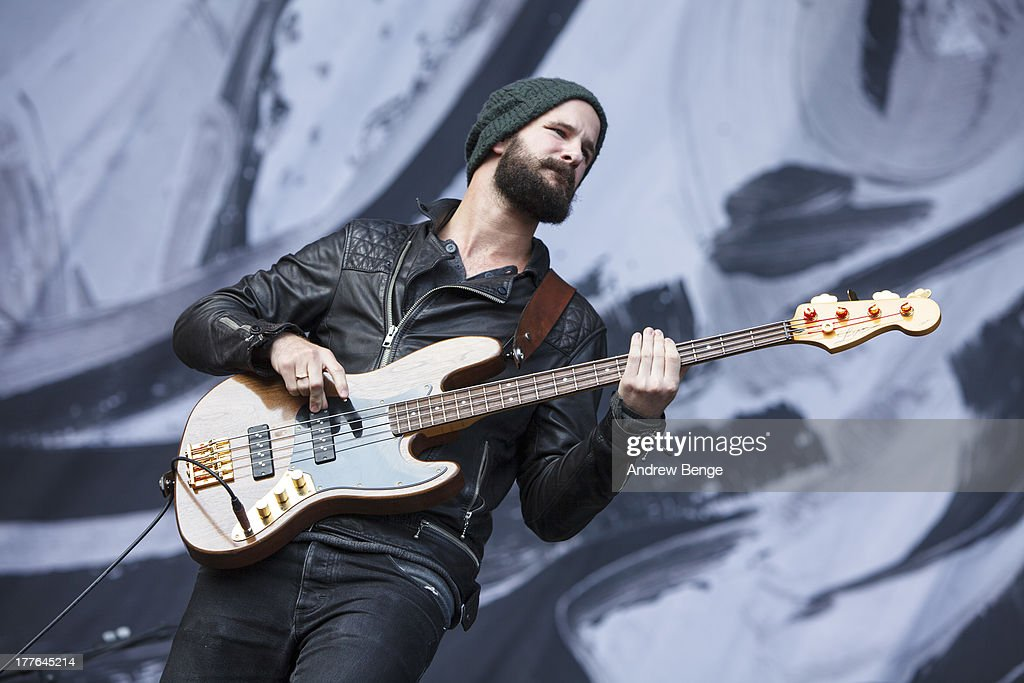 Charles Cave of White Lies performs on stage on Day 3 of Leeds Festival 2013 at Bramham Park on August 25 2013 in Leeds England