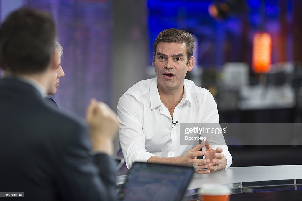 Charles 'Charlie' Hunt, chief executive officer of the Duvet & Pillow Warehouse Ltd., right, reacts during a Bloomberg Television interview in London, U.K., on Wednesday, 20, 2013. U.K. government figures show economic growth accelerated to 0.8 percent in the third quarter, the housing market is strengthening and about 60,000 jobs are being created every month, boosting taxes from company profits, payrolls, property purchases and sales. Photographer: Simon Dawson/Bloomberg via Getty Images