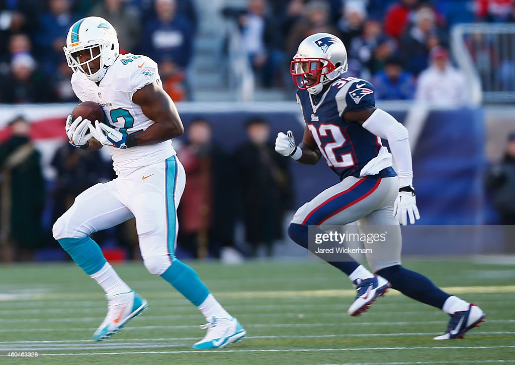 <a gi-track='captionPersonalityLinkClicked' href=/galleries/search?phrase=Charles+Clay&family=editorial&specificpeople=4624794 ng-click='$event.stopPropagation()'>Charles Clay</a> #42 of the Miami Dolphins catches a pass as <a gi-track='captionPersonalityLinkClicked' href=/galleries/search?phrase=Devin+McCourty&family=editorial&specificpeople=4510365 ng-click='$event.stopPropagation()'>Devin McCourty</a> #32 of the New England Patriots defends during the second quarter at Gillette Stadium on December 14, 2014 in Foxboro, Massachusetts.