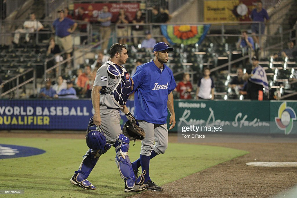 Charles Cutler #37 of Team Israel is walked off the field by <a gi-track='captionPersonalityLinkClicked' href=/galleries/search?phrase=Gabe+Kapler&family=editorial&specificpeople=171404 ng-click='$event.stopPropagation()'>Gabe Kapler</a> of Team Israel game 6 of the Qualifying Round of the World Baseball Classic at Roger Dean Stadium against Team Spain during on September 23, 2012 in Jupiter, Florida.
