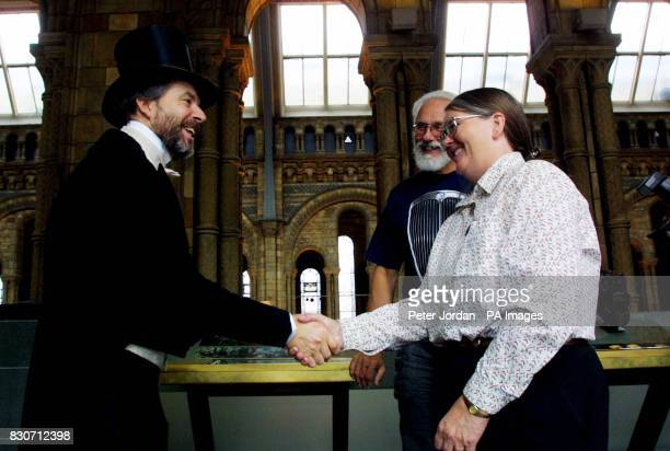 Charles Darwin gallery enactor at the Natural History Museum congratulates Bill and Arlene Stebbins of Whidbey Island Washington USA on their...