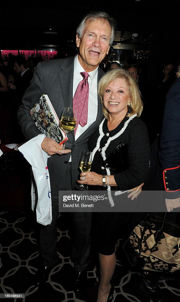 Charles Delevingne (L) and Elaine Paige attend the launch of Joan Collins new book 'Passion For Life' at No.41 Mayfair Club at The Westbury Hotel on October 21, 2013 in London, England.