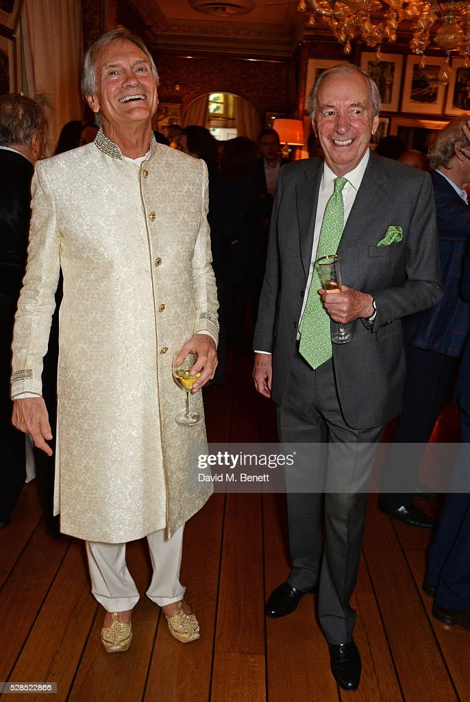 <a gi-track='captionPersonalityLinkClicked' href=/galleries/search?phrase=Charles+Delevingne&family=editorial&specificpeople=4354613 ng-click='$event.stopPropagation()'>Charles Delevingne</a> (L) attends the launch of Dame Joan Collins' new book 'The St. Tropez Lonely Hearts Club' at Harry's Bar on May 5, 2016 in London, England.