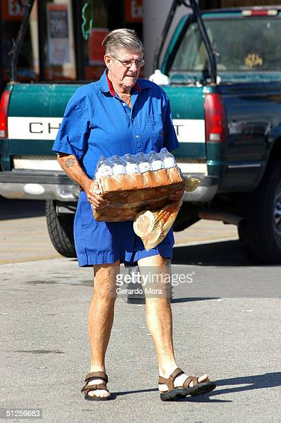 Charles Devine stocks up on drinking water to prepare for Hurricane Frances September 2 2004 in Orlando Florida Hurricane Frances is heading toward...