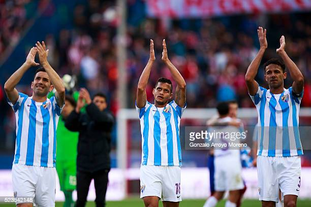 Charles Dias de Oliveira of Malaga CF and his teammates Roberto Rosales and Weligton Robson wave their fans after loosing the La Liga match between...
