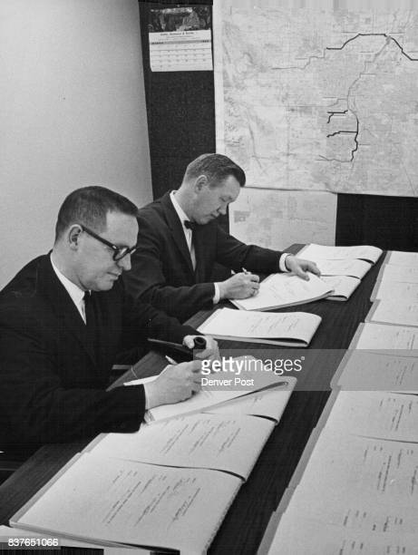 Charles E Rhyne and Robert S Wham chairman and secretary respectively of the Metropolitan Denver Sewage disposal District No 1 Monday sign the final...