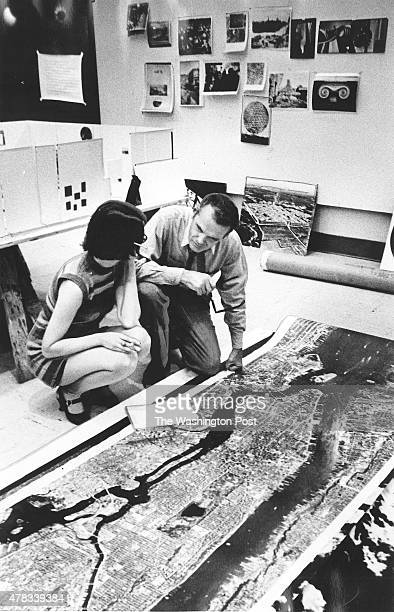 Charles Eames and an assistant Barbara Charles work on a Smithsonian Institution exhibit about photography and the city