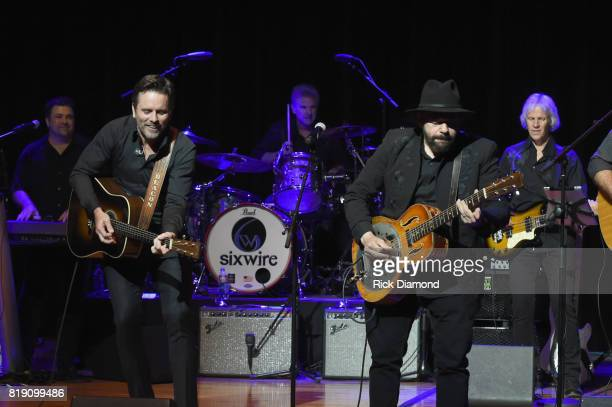 Charles Esten and Colin Linden perform on stage for Charles Esten's #OneSingleYear Celebration Concert at CMA Theater at the Country Music Hall of...