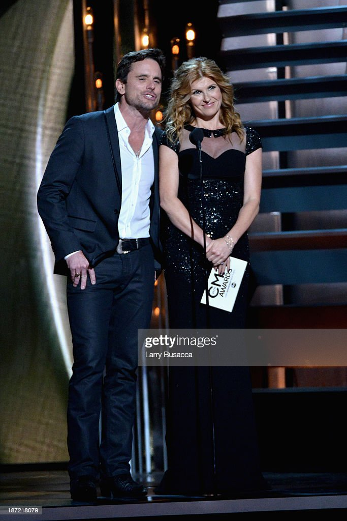 Charles Esten (L) and <a gi-track='captionPersonalityLinkClicked' href=/galleries/search?phrase=Connie+Britton&family=editorial&specificpeople=234699 ng-click='$event.stopPropagation()'>Connie Britton</a> speak onstage during the 47th Annual CMA awards at the Bridgestone Arena on November 6, 2013 in Nashville, United States.