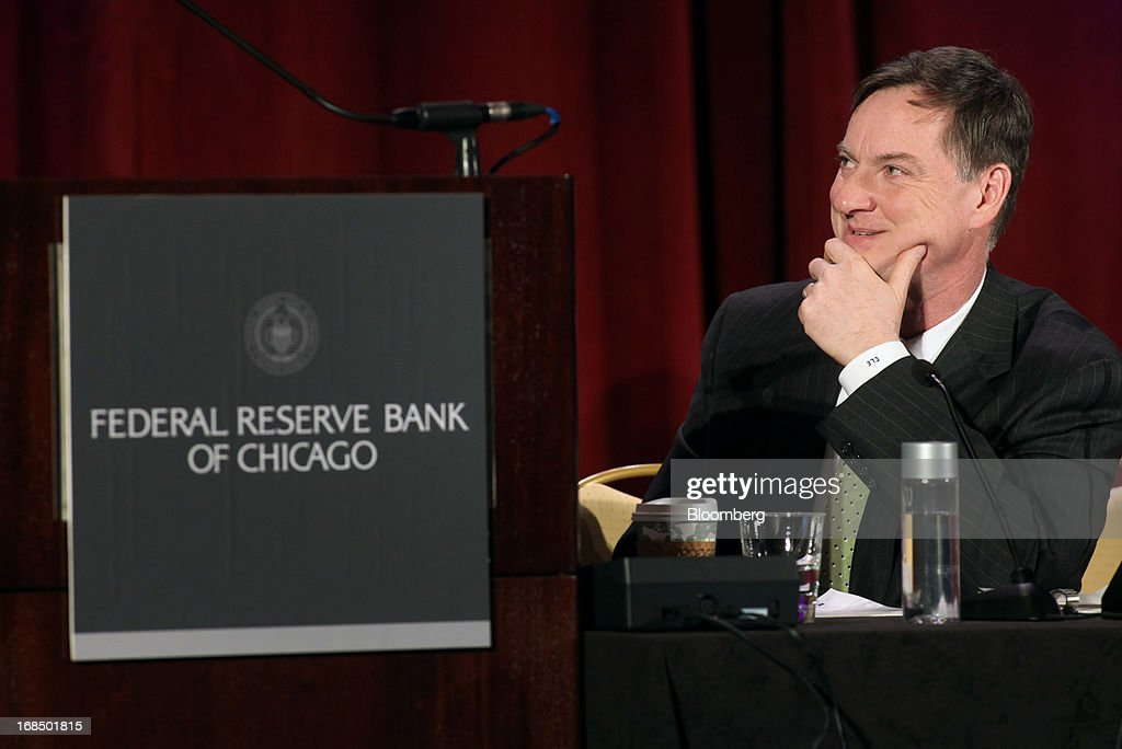 Charles Evans, president and chief executive officer of the Federal Reserve Bank of Chicago, listens while Ben S. Bernanke, chairman of the U.S. Federal Reserve, unseen, speaks during the 49th Annual Conference on Bank Structure and Competition in Chicago, Illinois, U.S., on Friday, May 10, 2013. Federal Reserve Chairman Ben S. Bernanke said risks persist in wholesale funding markets used frequently by Wall Street brokers to finance securities trading. Photographer: Tim Boyle/Bloomberg via Getty Images