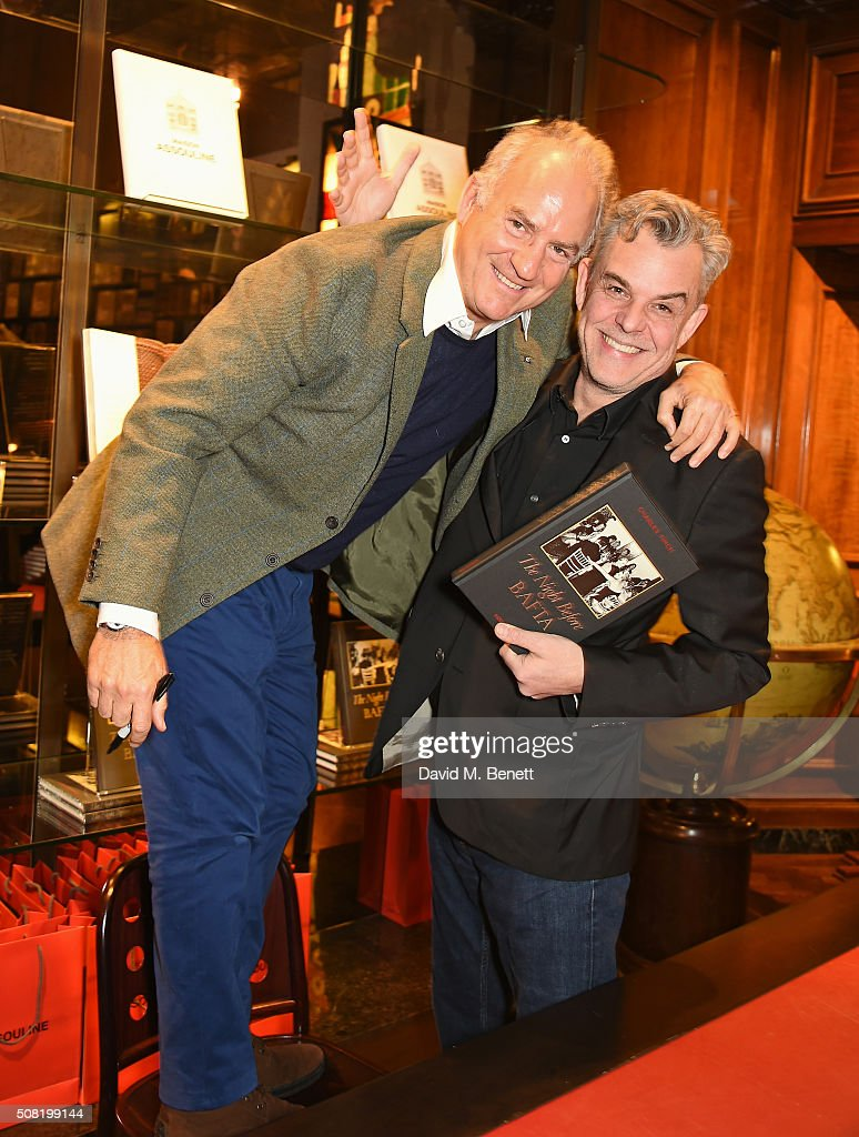 Charles Finch and Danny Huston attend the launch of 'The Night Before BAFTA' by Charles Finch at Maison Assouline on February 3 2016 in London England