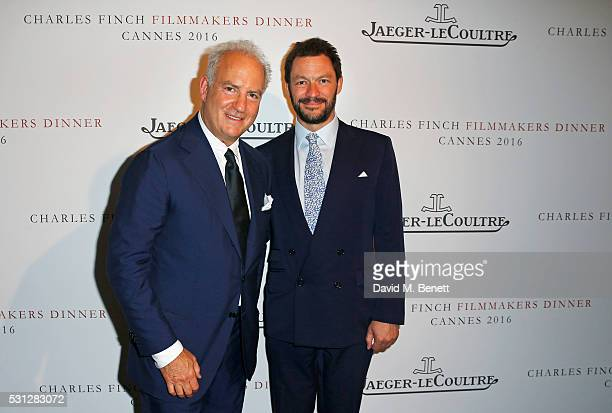 Charles Finch and Dominic West attend The 8th Annual Filmmakers Dinner hosted by Charles Finch and JaegerLeCoultre at Hotel du CapEden Roc on May 13...