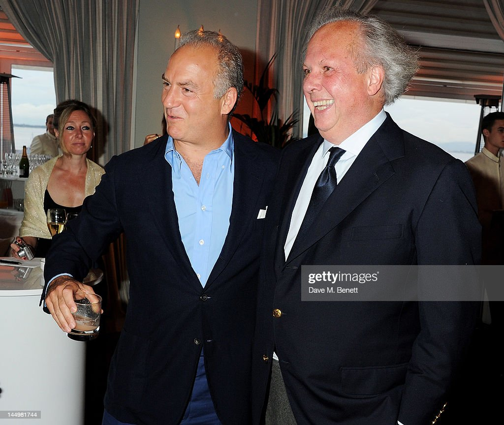Charles Finch (L) and Vanity Fair editor Graydon Carter attend the IWC and Finch's Quarterly Review Annual Filmmakers Dinner at Hotel Du Cap-Eden Roc on May 21, 2012 in Antibes, France.