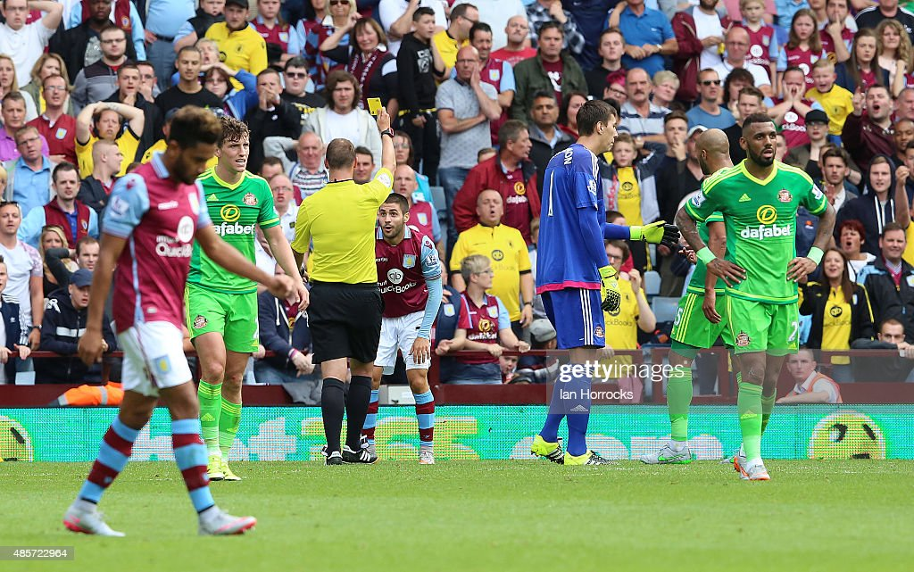 Charles Gil of Aston Villa (C) gets a yellow card for a dive in the Sunderland box during the Barclays Premier League match between Aston Villa and Sunderland on August 29, 2015 at Villa Park in Birmingham, England.