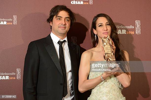 Charles Gillibert and Deniz Gamze Erguven pose with their awards of Best Script and Best First Feature for the movie 'Mustang' during The Cesar Film...
