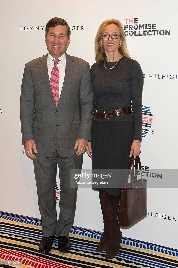 Charles H. Rivkin (L) and wife attend Preppy with a twist African Event at Tommy Hilfiger Champs Elysees Flagship on April 26, 2012 in Paris, France.