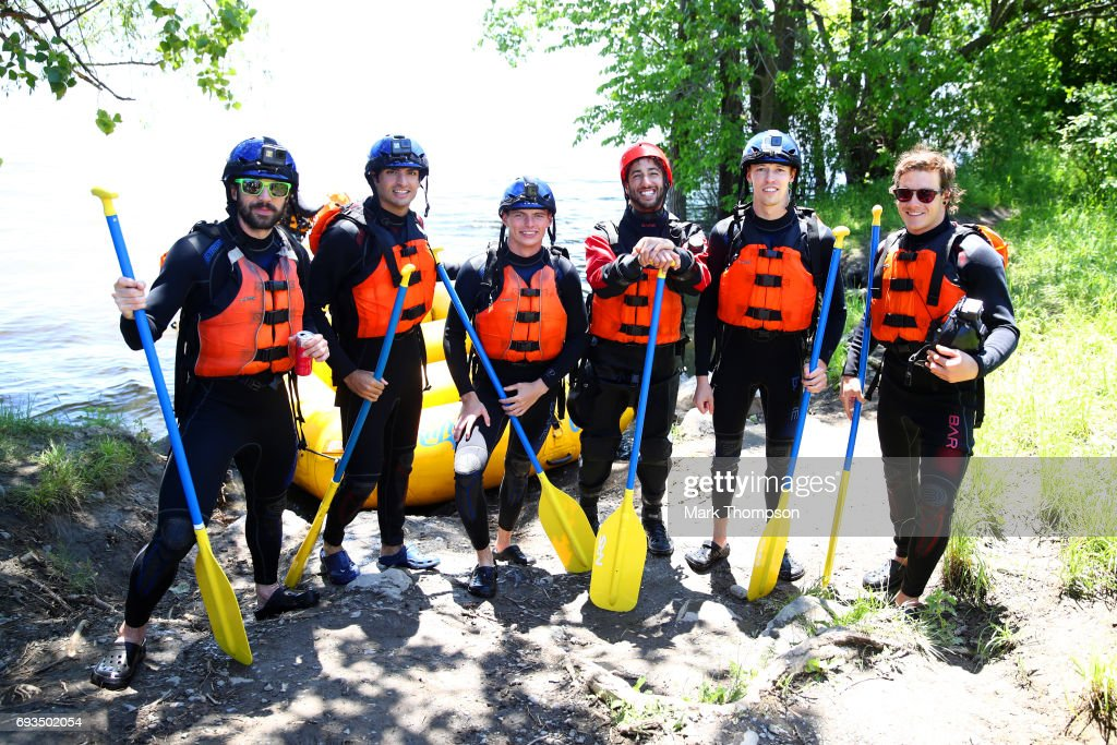 Charles Hamelin, Carlos Sainz of Spain and Scuderia Toro Rosso, Max Verstappen of the Netherlands and Red Bull Racing, Daniel Ricciardo of Australia and Red Bull Racing, Daniil Kvyat of Russia and Scuderia Toro Rosso and Sebastien Toutant pose after taking part in a rafting session in the Lachine Rapids on the Saint Lawrence River at Montreal Rafting during previews to the Canadian Formula One Grand Prix on June 7, 2017 in Montreal, Canada.