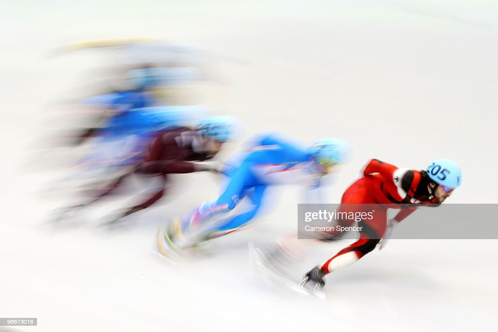 <a gi-track='captionPersonalityLinkClicked' href=/galleries/search?phrase=Charles+Hamelin&family=editorial&specificpeople=820316 ng-click='$event.stopPropagation()'>Charles Hamelin</a> of Canada leads the pack in the Men's 1500 m Short Track finals on day 2 of the Vancouver 2010 Winter Olympics at Pacific Coliseum on February 13, 2010 in Vancouver, Canada.