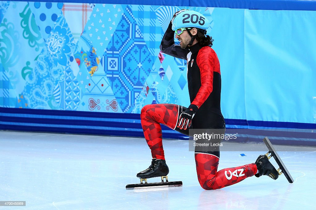 <a gi-track='captionPersonalityLinkClicked' href=/galleries/search?phrase=Charles+Hamelin&family=editorial&specificpeople=820316 ng-click='$event.stopPropagation()'>Charles Hamelin</a> of Canada reacts after falling while competingin the Short Track Men's 500m Heat at Iceberg Skating Palace on day 11 of the 2014 Sochi Winter Olympics on February 18, 2014 in Sochi, Russia.
