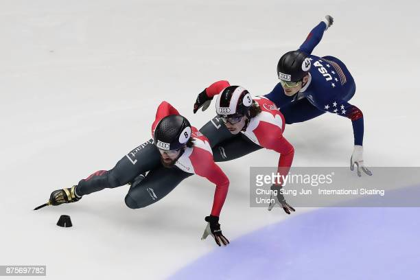 Charles Hamelin of Canada Samuel Girard of Canada and JohnHenry Krueger of United States compete in the Men 1500m Semifinals during the Audi ISU...