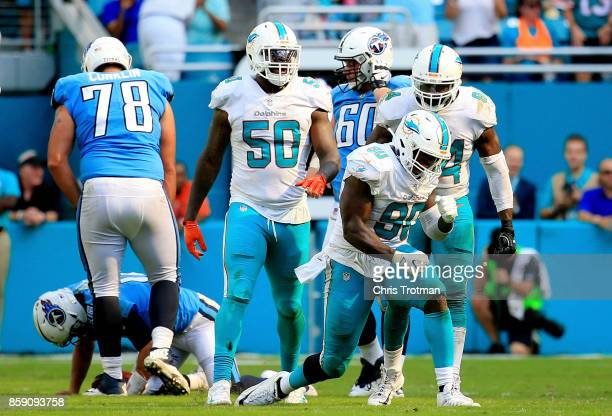 Charles Harris Andre Branch and Lawrence Timmons of the Miami Dolphins celebrate after sacking Matt Cassel of the Tennessee Titans in the fourth...