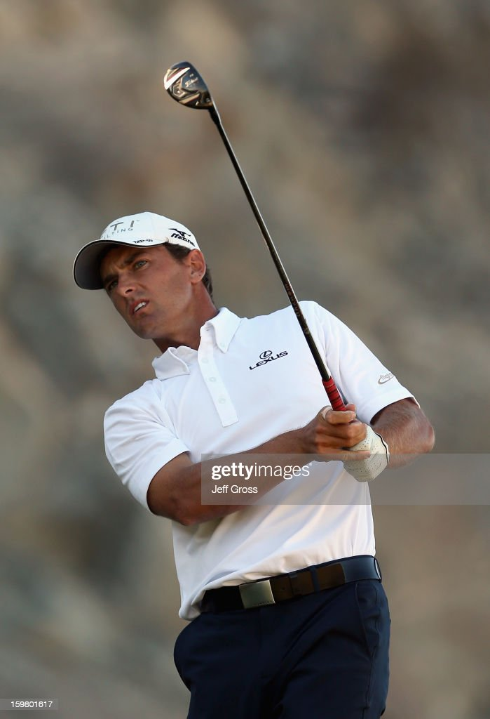 <a gi-track='captionPersonalityLinkClicked' href=/galleries/search?phrase=Charles+Howell+III&family=editorial&specificpeople=212774 ng-click='$event.stopPropagation()'>Charles Howell III</a> hits a tee shot on the 16th hole during the final round of the Humana Challenge In Partnership With The Clinton Foundation at the Palmer Private Course at PGA West on January 20, 2013 in La Quinta, California.